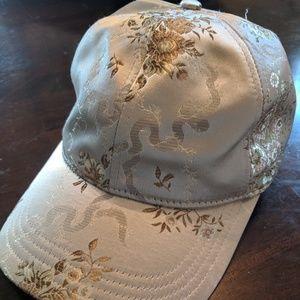 Brand new brocade gold, cream hat